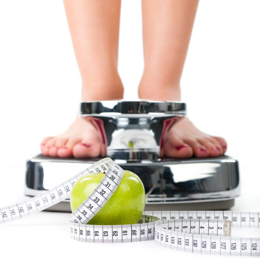 Woman on a scale for weight management
