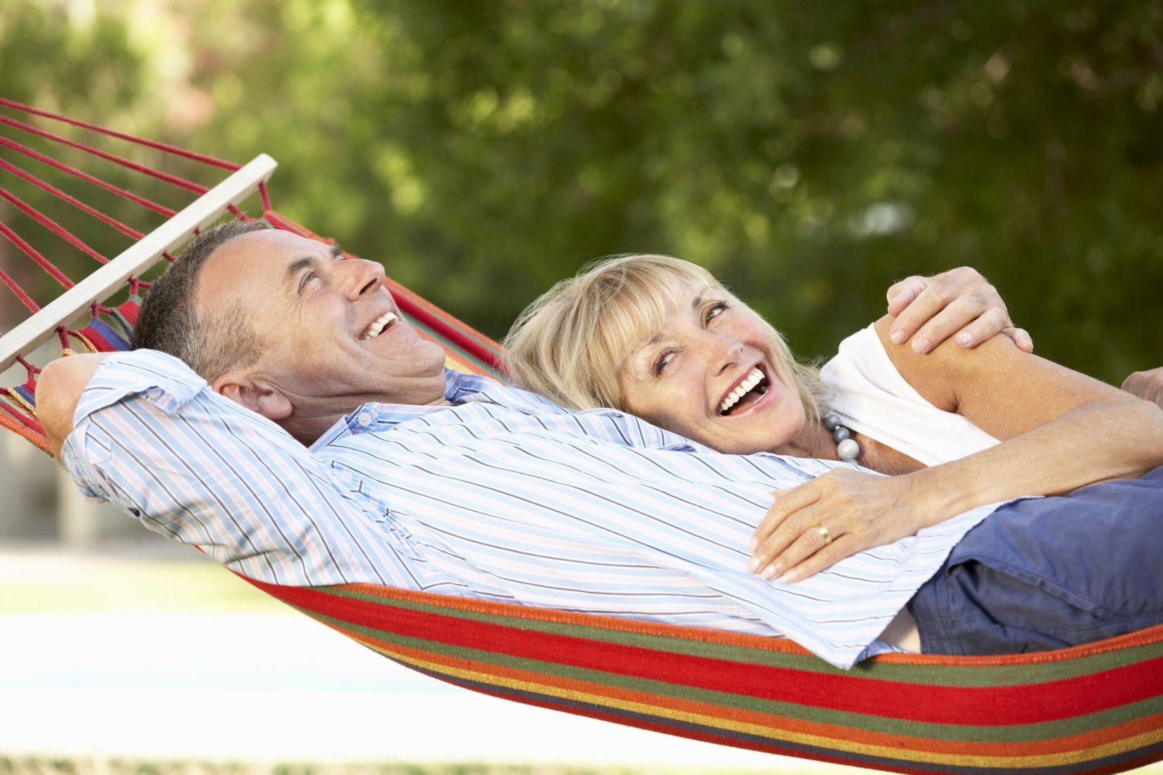Senior couple outside relaxing in hammock