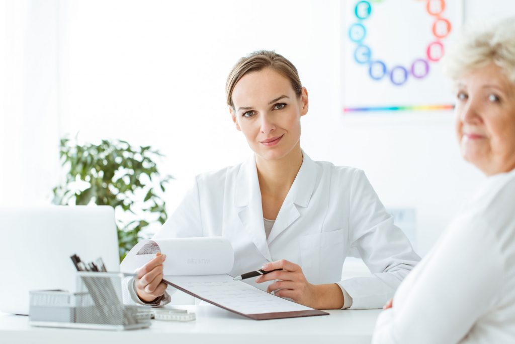 Female doctor holding measurements results