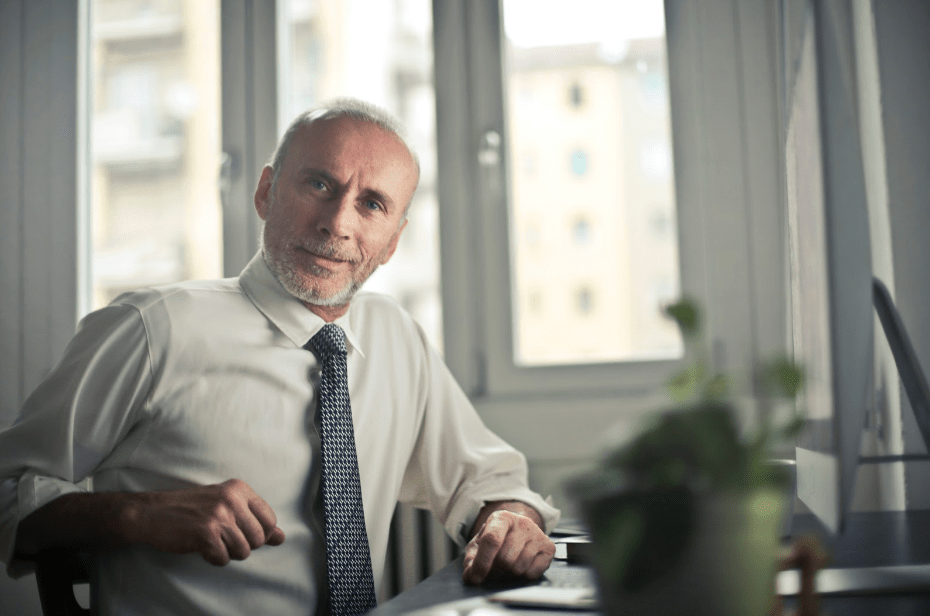 Confident Man at Computer Desk Discussing Erectile Dysfunction Treatment