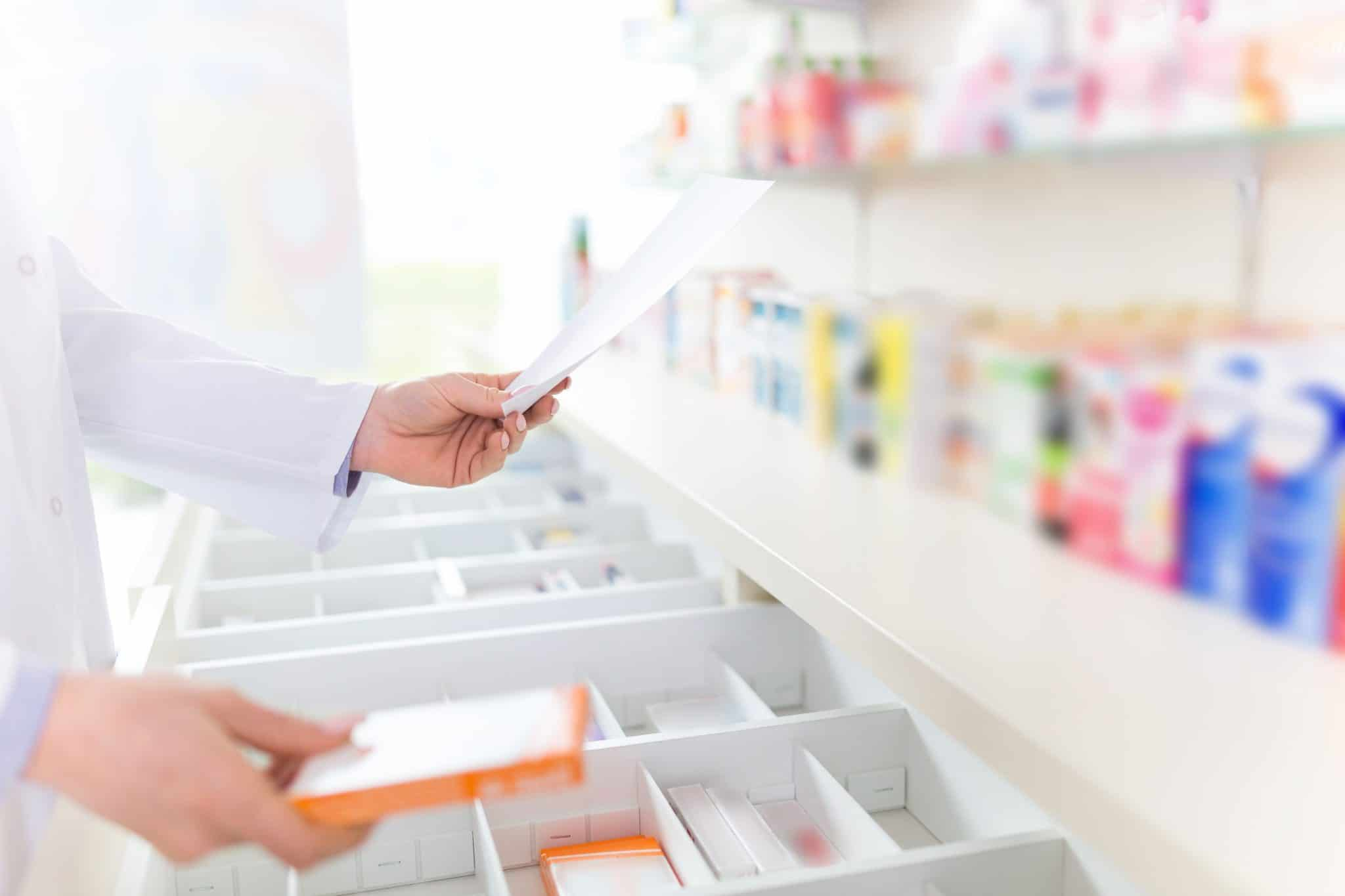 Pharmacist Holding Document and Prescription Box