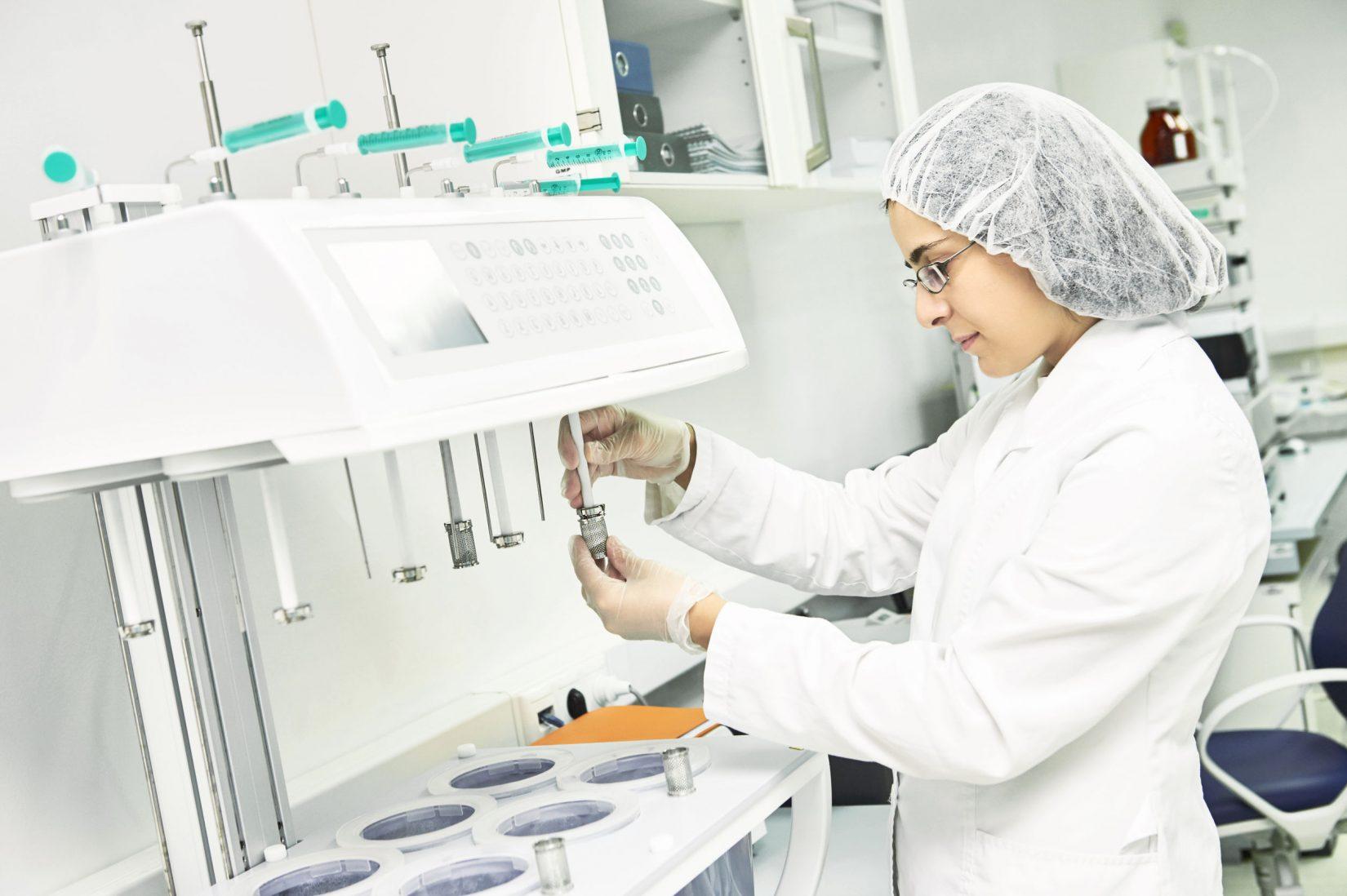 Lab tech filling up bottle
