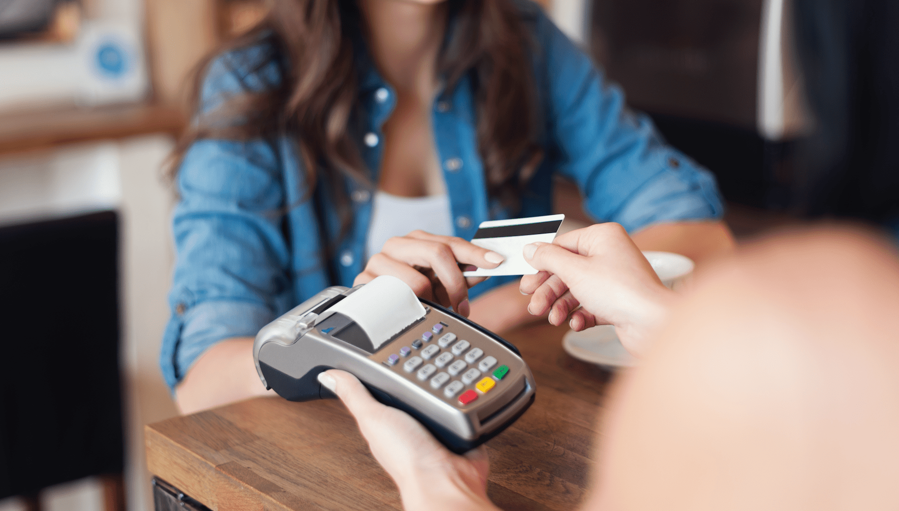 Woman Making In-Person Credit Card Payment