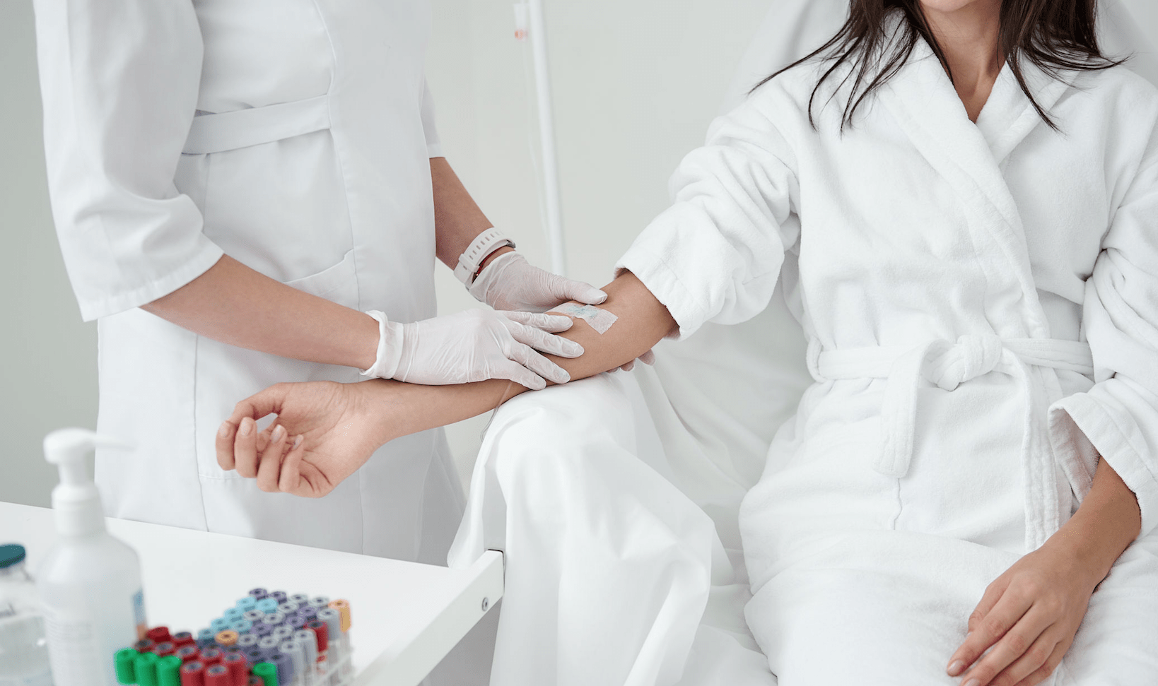 woman receiving IV therapy in sterile environment from licensed professional